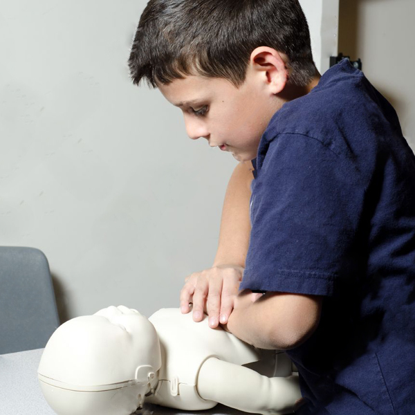 12500329-A-9-years-old-child-practing-CPR-on-a-dummy–Stock-Photo-cpr